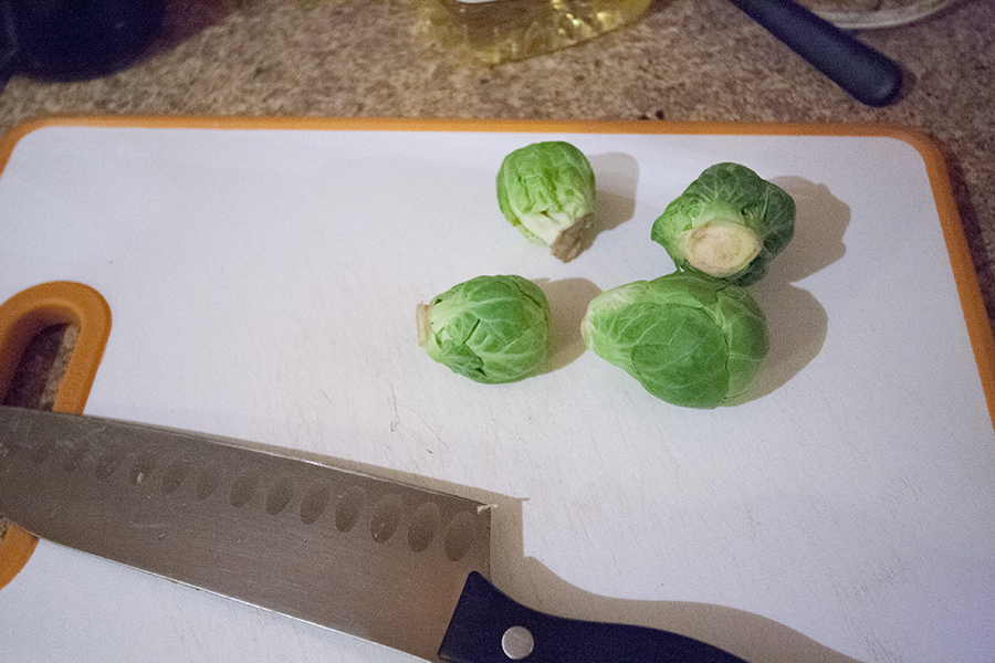 Pre-cutting Brussels sprouts.